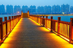 Golden brown wooden footway Royalty Free Stock Image