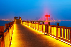 Golden brown wooden trestle and chinese knot which red light shine Stock Photo