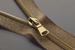 Golden brown zipper Stock Images