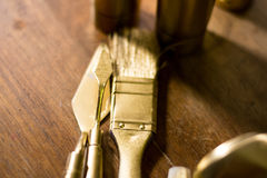 Golden brush and spatula close up Royalty Free Stock Photography