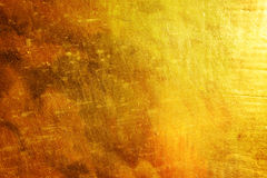 Golden brush strokes background with scratch Stock Image