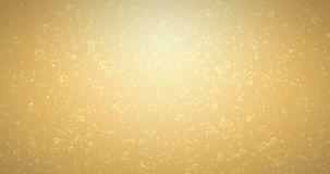 Golden bubbles movement inside a glass of champagne on gold background