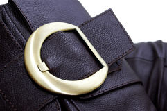 Golden buckle of leather brown boot Royalty Free Stock Photography