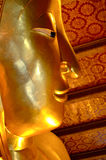 Golden Buddah. Profile shot of a golden Buddha head Stock Image