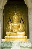 Golden Buddha. A seated golden Buddha at Wat Trai Mit in Bangkok, Thailand stock images