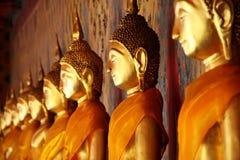 Golden Buddha. Image arrange in arcade at temple, Bangkok, Thailand Royalty Free Stock Photos
