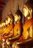 Golden Buddha. Image arrange in arcade at temple, Bangkok, Thailand Stock Photo