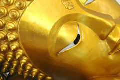 Golden Buddha. A close up image of the side of the face of  golden Buddha statue in a temple in Bangkok, Thailand Stock Photos