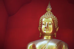 Golden Buddha Against A Red Background Stock Images