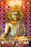 The golden buddha in the ancient temple, Thailand Stock Photos