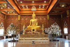 Golden Buddha in Ang Thong, Thailand. A Buddha sits in Ang Thong, Thailand near the laying down Buddha. Its golden reflection, giant fingernails, and huge Stock Images