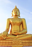 Golden Buddha and blue sky background Stock Photos