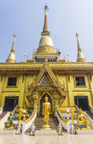 Golden buddha and blue sky. Golden Buddha on blue background Stock Images