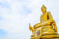 Golden Buddha with blue sky backgrounds Stock Photo
