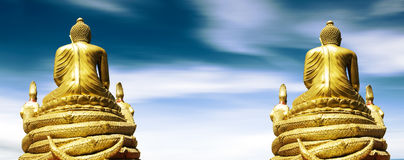 Golden buddha on blue sky.Meditation concept Royalty Free Stock Photo