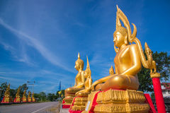 Golden buddha on blue sky Royalty Free Stock Photo