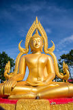 Golden buddha on blue sky Royalty Free Stock Image