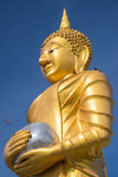Golden buddha on blue sky Royalty Free Stock Photography