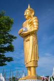Golden buddha on blue sky Stock Photos