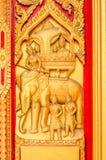 Golden Buddha Carving on Temple Door. Golden Buddha Carving on the door,Thailand Stock Photos