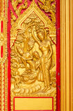 Golden Buddha Carving on Temple Door Stock Photo