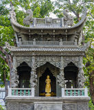 Golden buddha in Chinese shrine Stock Photos