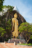 Golden Buddha on the cliff Royalty Free Stock Photography