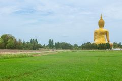 Golden Buddha in countryside in Thailand landscape in rural Stock Photo