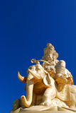 Golden Buddha and eleventh with blue sky Royalty Free Stock Image