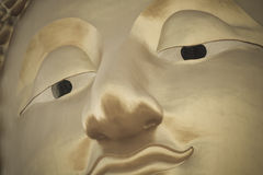 Golden Buddha face Stock Image