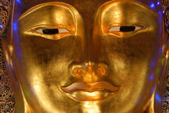 Golden buddha face Stock Photography