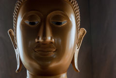 Golden buddha face. Face of a gold leaf gilded buddha in Phuket royalty free stock image