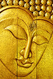 Golden buddha face made by carving wood Royalty Free Stock Photography