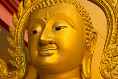 The golden Buddha faces. Stock Photos