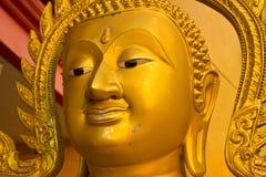 The golden Buddha faces. Stock Photos