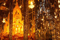 Golden buddha in glass church . Royalty Free Stock Image