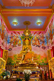 Golden Buddha in the grand mural hall. Golden Buddha in an ancient temple hall in Bangkok, Thailand Stock Photos