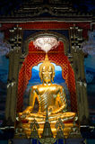 Golden Buddha in the grand temple Stock Images