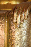 Golden Buddha hands Stock Images