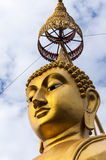 Golden Buddha head & parasol. At a temple in southern Thailand Royalty Free Stock Photography