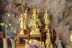Golden buddha image in the cave Royalty Free Stock Photo