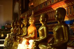 The golden Buddha image. Reverence in Buddhist sutras At Wat Luang Pothit, Thailand Stock Photos