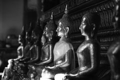 The golden Buddha image. Reverence in Buddhist sutras At Wat Luang Pothit, Thailand Royalty Free Stock Photo