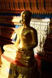 The golden Buddha image. Reverence in Buddhist sutras At Wat Luang Pothit, Thailand Royalty Free Stock Images