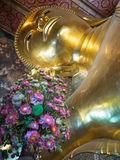 Golden Buddha image head close up with flowers Royalty Free Stock Photography