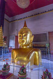 A golden Buddha image interred up to the cheat in Wat Phra Thong Royalty Free Stock Image
