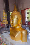 A golden Buddha image interred up to the cheat in Wat Phra Thong Royalty Free Stock Photos