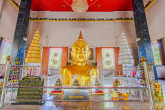 a golden Buddha image interred up to the cheat in Wat Phra Thong Royalty Free Stock Photo