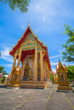 A golden Buddha image interred up to the cheat in Wat Phra Thong Stock Image