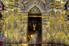 Golden Buddha image in golden pagoda with details of Thai art in a Buddhist temple in Thailand. royalty free stock photos